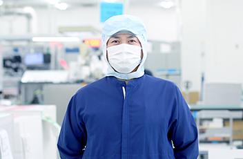 製造部 部長 塚田 泰志